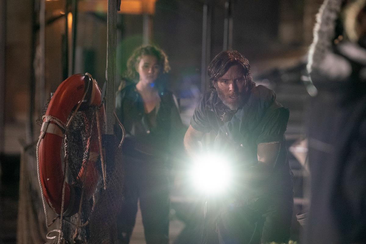 """Regan (Millicent Simmonds) and Emmett (Cillian Murphy) brave the unknown in """"A Quiet Place Part II."""" Cr: Paramount Pictures"""