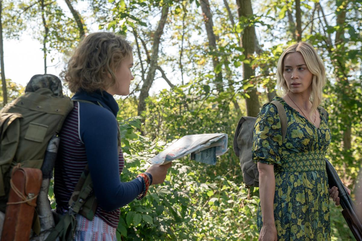 """Regan (Millicent Simmonds), left, and Evelyn (Emily Blunt) brave the unknown in """"A Quiet Place Part II."""" Cr: Paramount Pictures"""