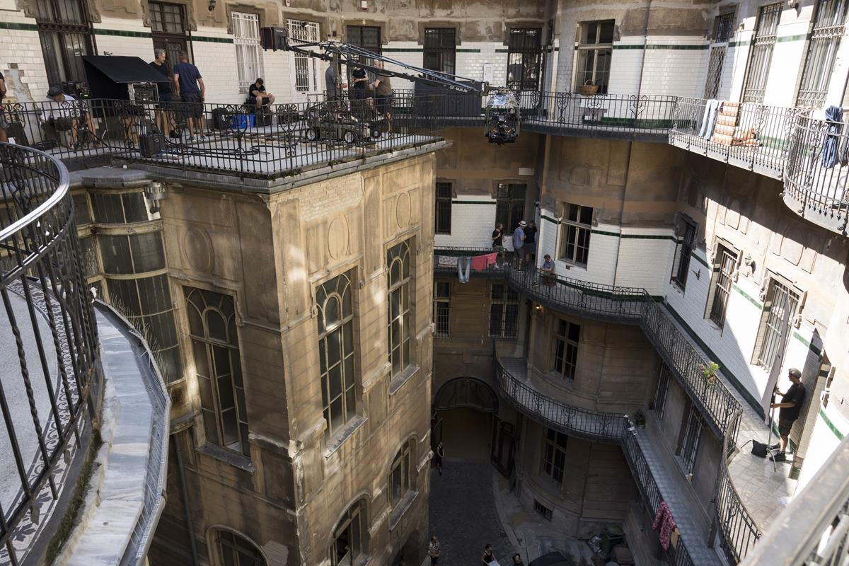 """On location on the rooftop of the former Budapest Stock Exchange for Marvel's """"Black Widow."""" Cr: Marvel Studios"""