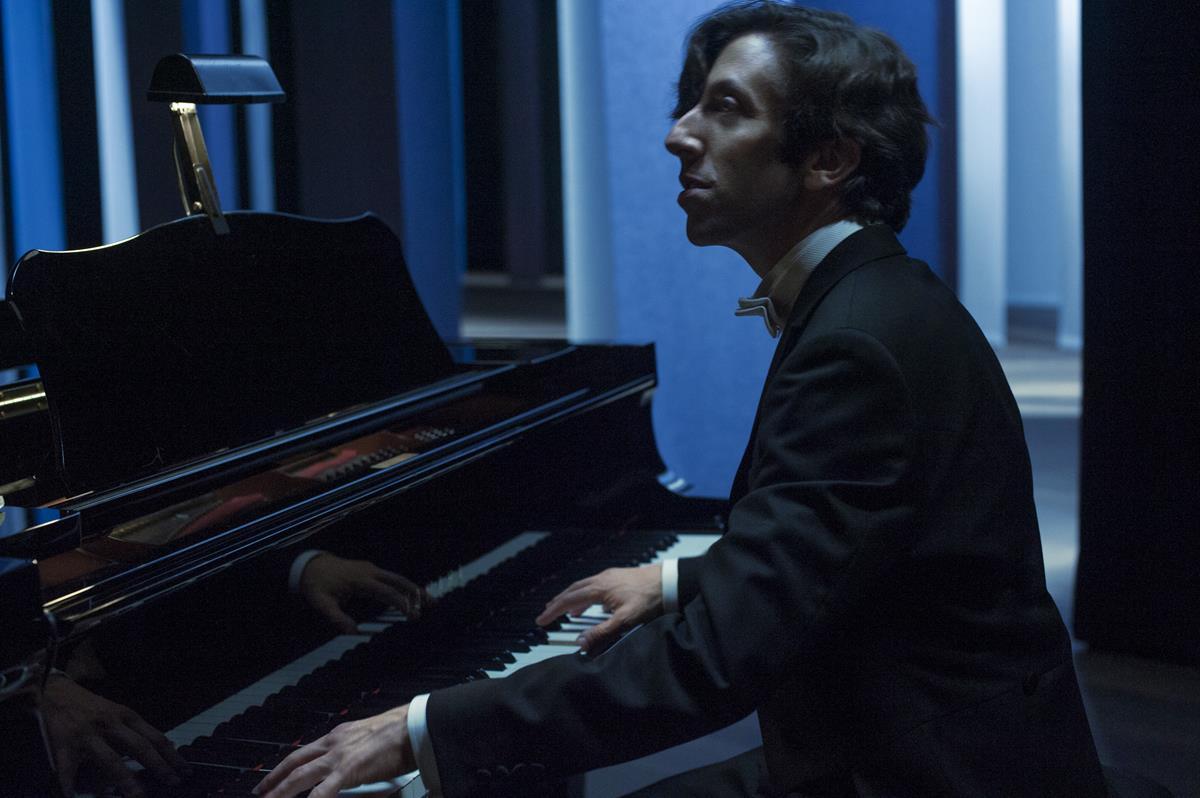 "Simon Helberg as The Conductor in director Leos Carax's ""Annette."" Cr: Amazon Studios"