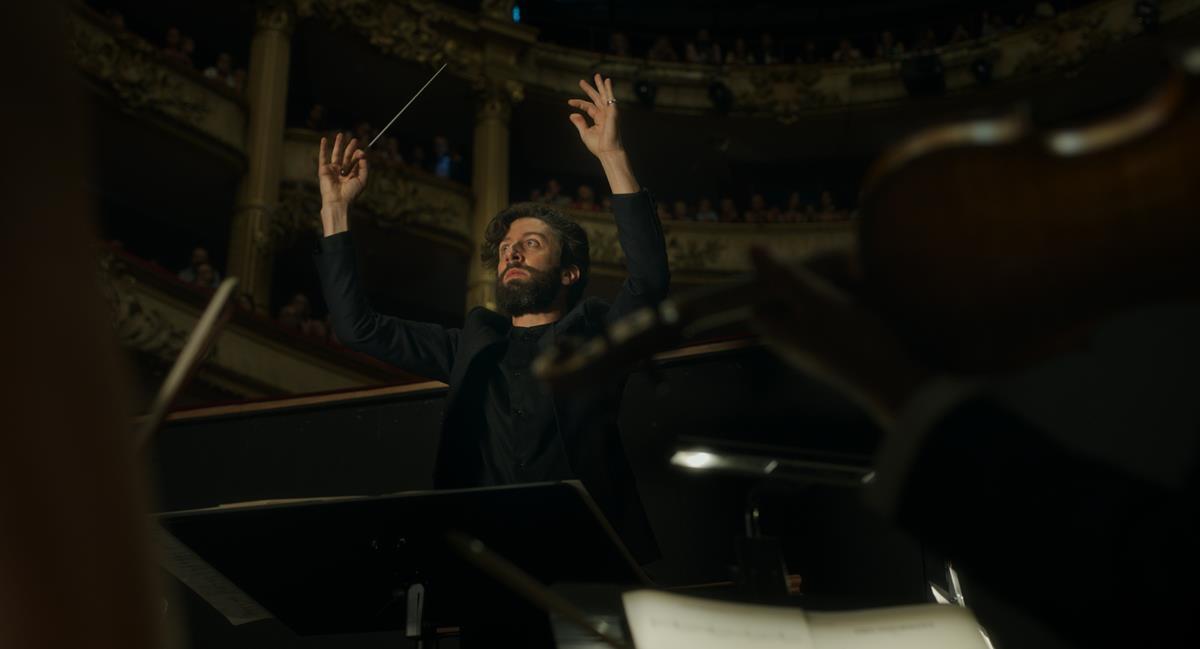 "Simon Helberg as The Conductor in director Leos Carax's ""Annette."" Cr: Kris Dewitte/Amazon Studios"