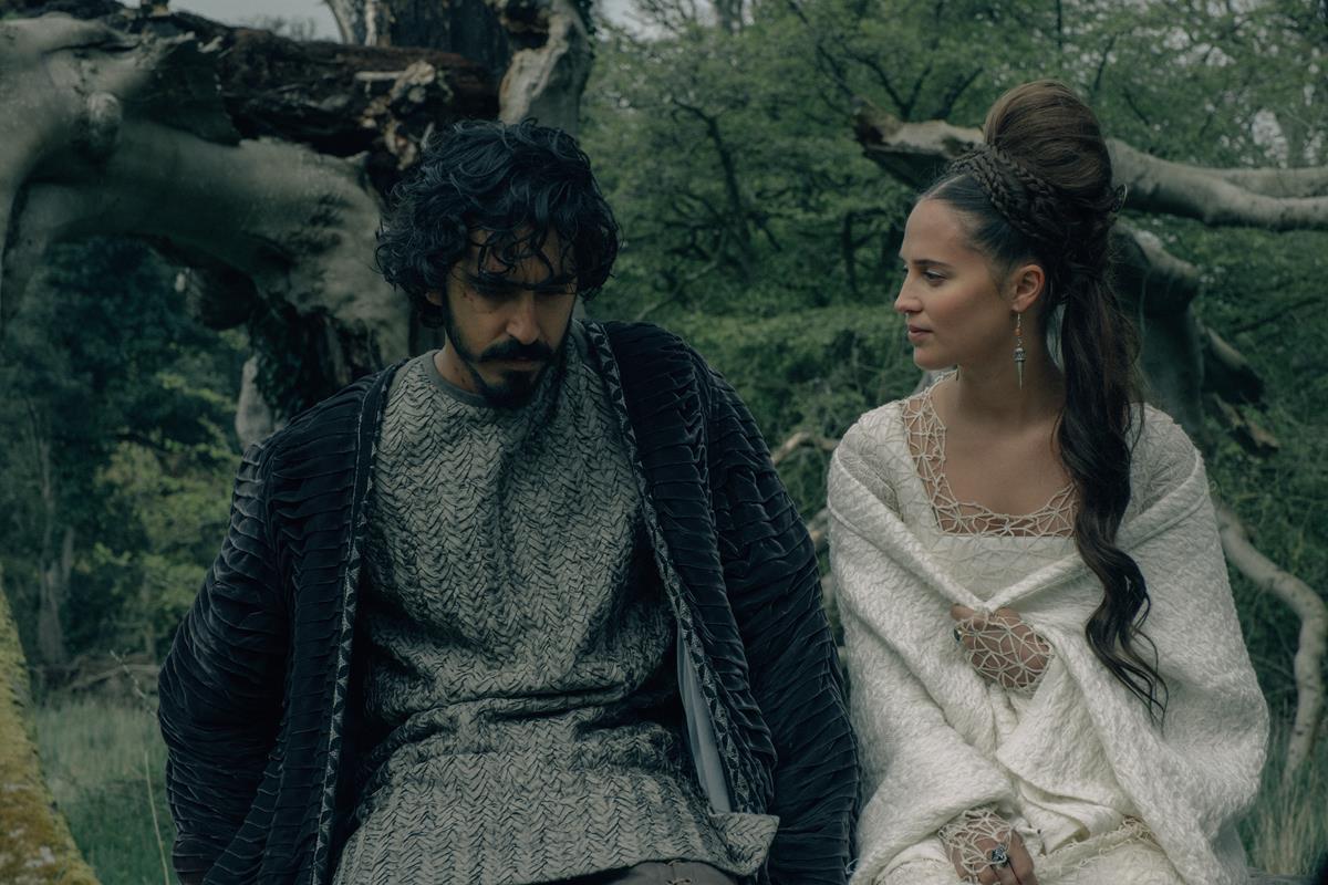 """Dev Patel and Alicia Vikander in """"The Green Knight."""" Cr: Eric Zachanowich/A24"""