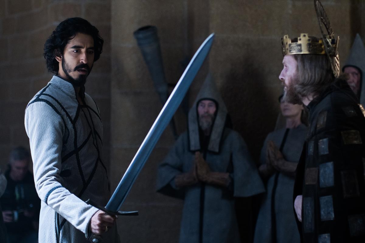 "Dev Patel and Sean Harris in ""The Green Knight."" Cr: Eric Zachanowich/A24"