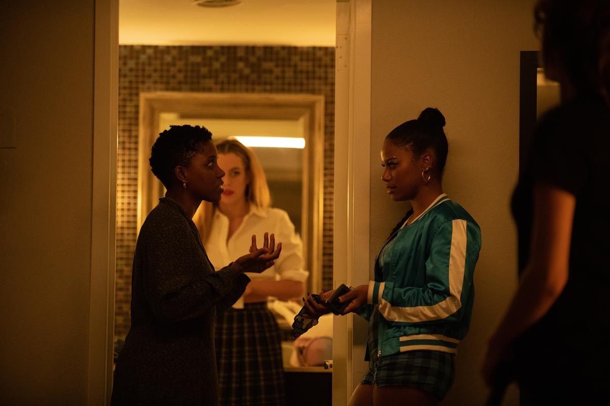 "Director Janicza Bravo, Riley Keough and Taylour Paige on the set of ""Zola."" Cr: Anna Kooris/A24"