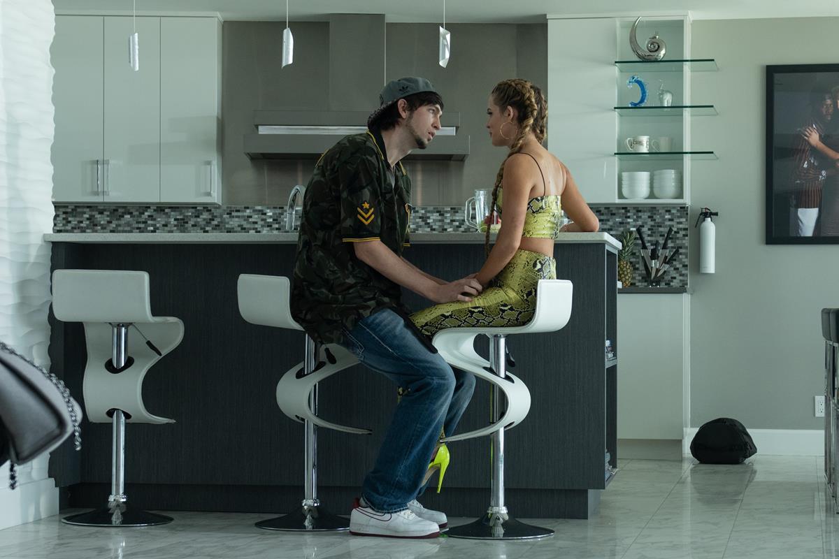 "Nicholas Braun as Derrek and Riley Keough as Stefani in director Janicza Bravo's ""Zola."" Cr: Anna Kooris/A24"