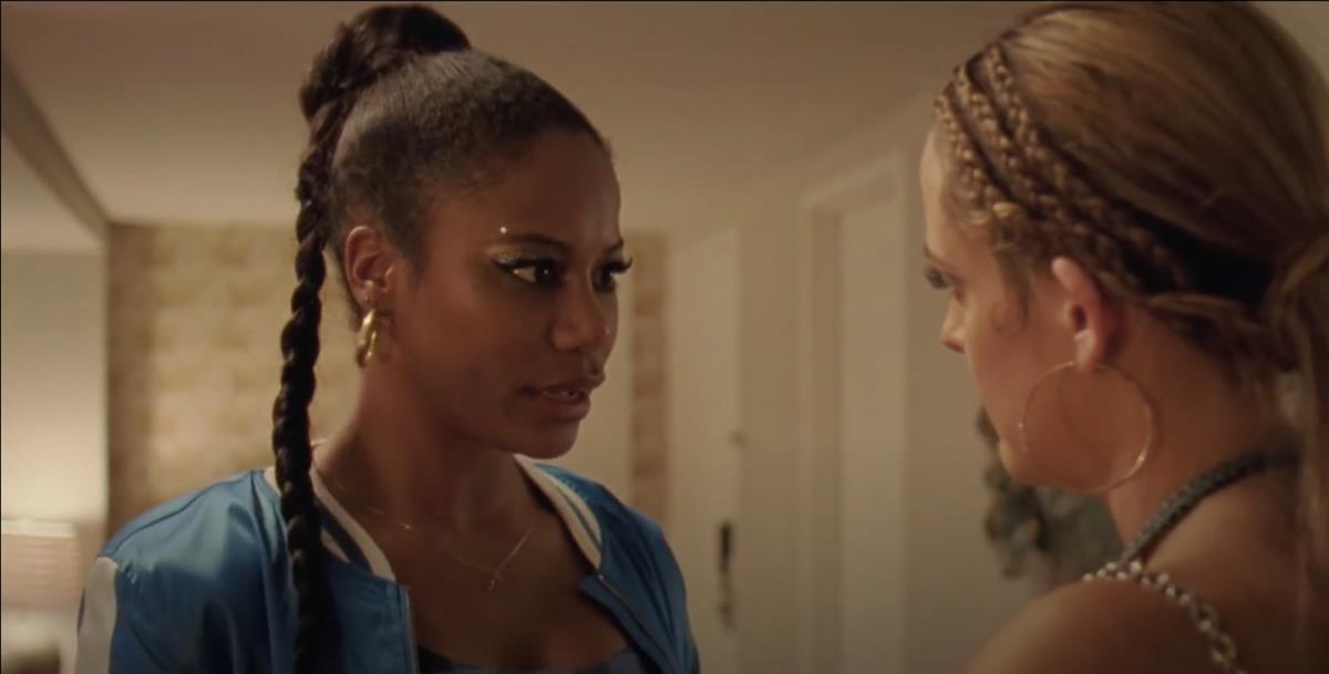 "Taylour Paige as Zola and Riley Keough as Stefani in director Janicza Bravo's ""Zola."" Cr: Anna Kooris/A24"