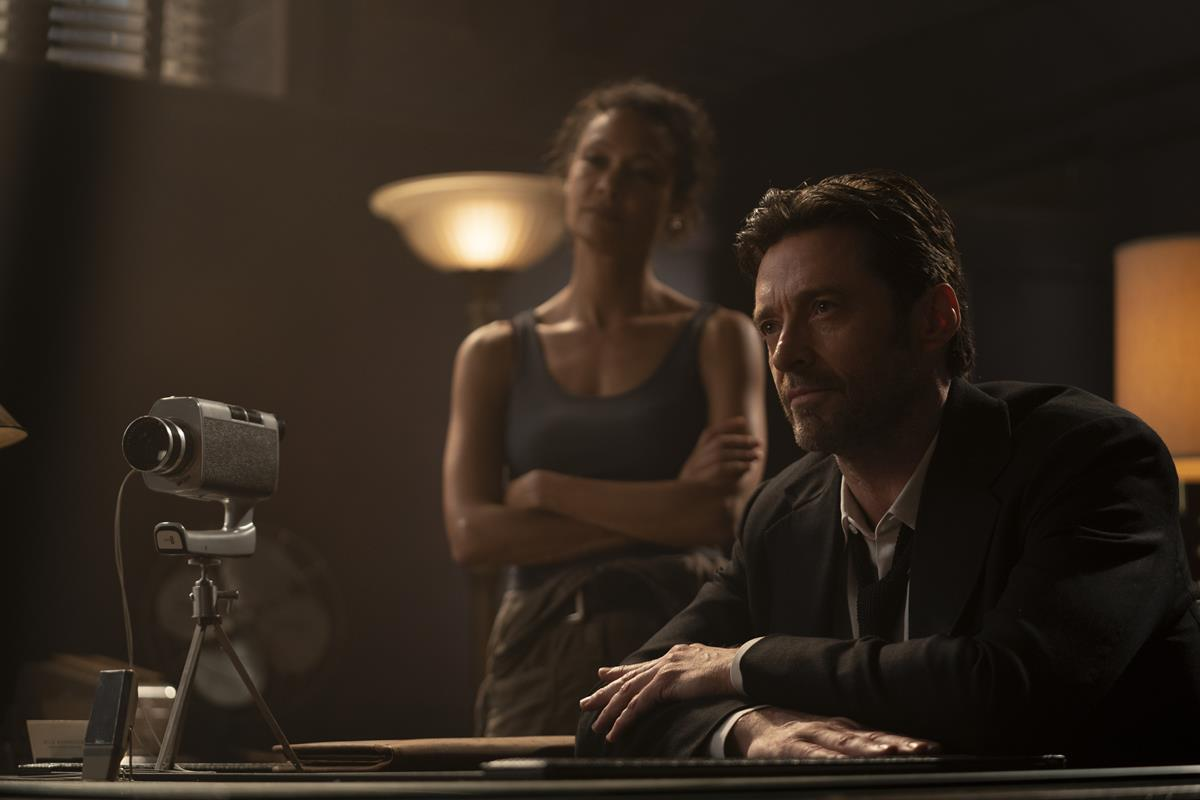 """Thandiwe Newton as Watts and Hugh Jackman as Nick Bannister in """"Reminiscence."""" Cr: Warner Bros. Pictures"""