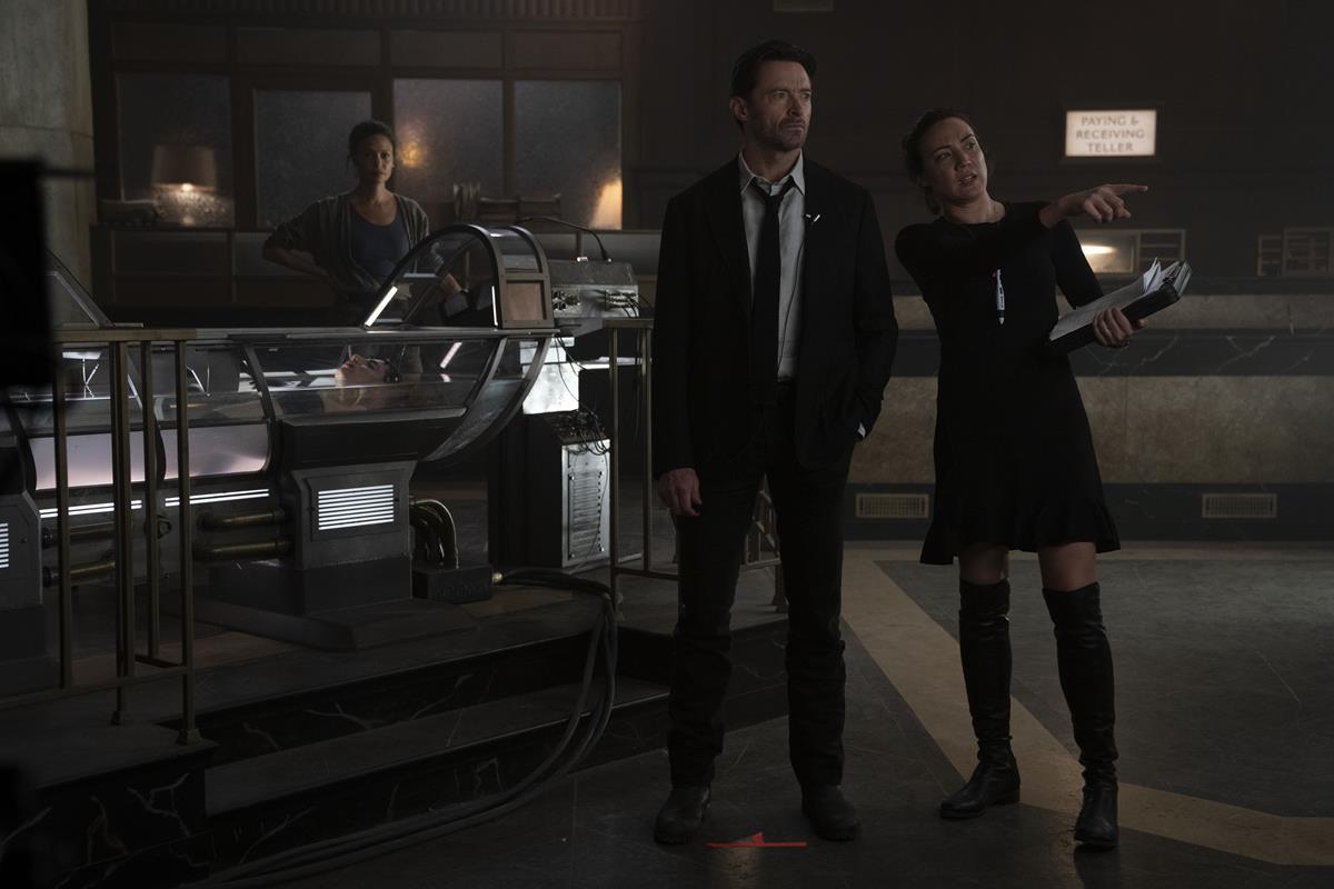 "Thandiwe Newton, Hugh Jackman, and director Lisa Joy on the set of ""Reminiscence."" Cr: Warner Bros. Pictures"
