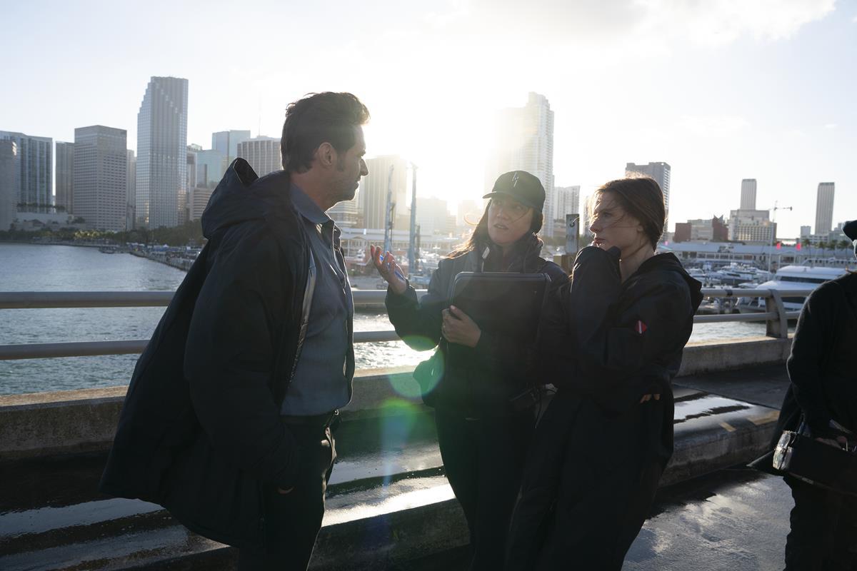 "Hugh Jackman, director Lisa Joy, and Rebecca Ferguson on the set of ""Reminiscence."" Cr: Warner Bros. Pictures"