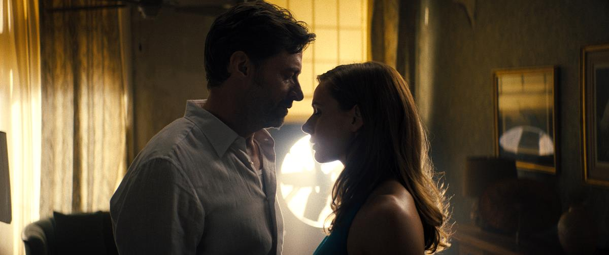 """Hugh Jackman as Nick Bannister and Rebecca Ferguson as Mae in """"Reminiscence."""" Cr: Warner Bros. Pictures"""