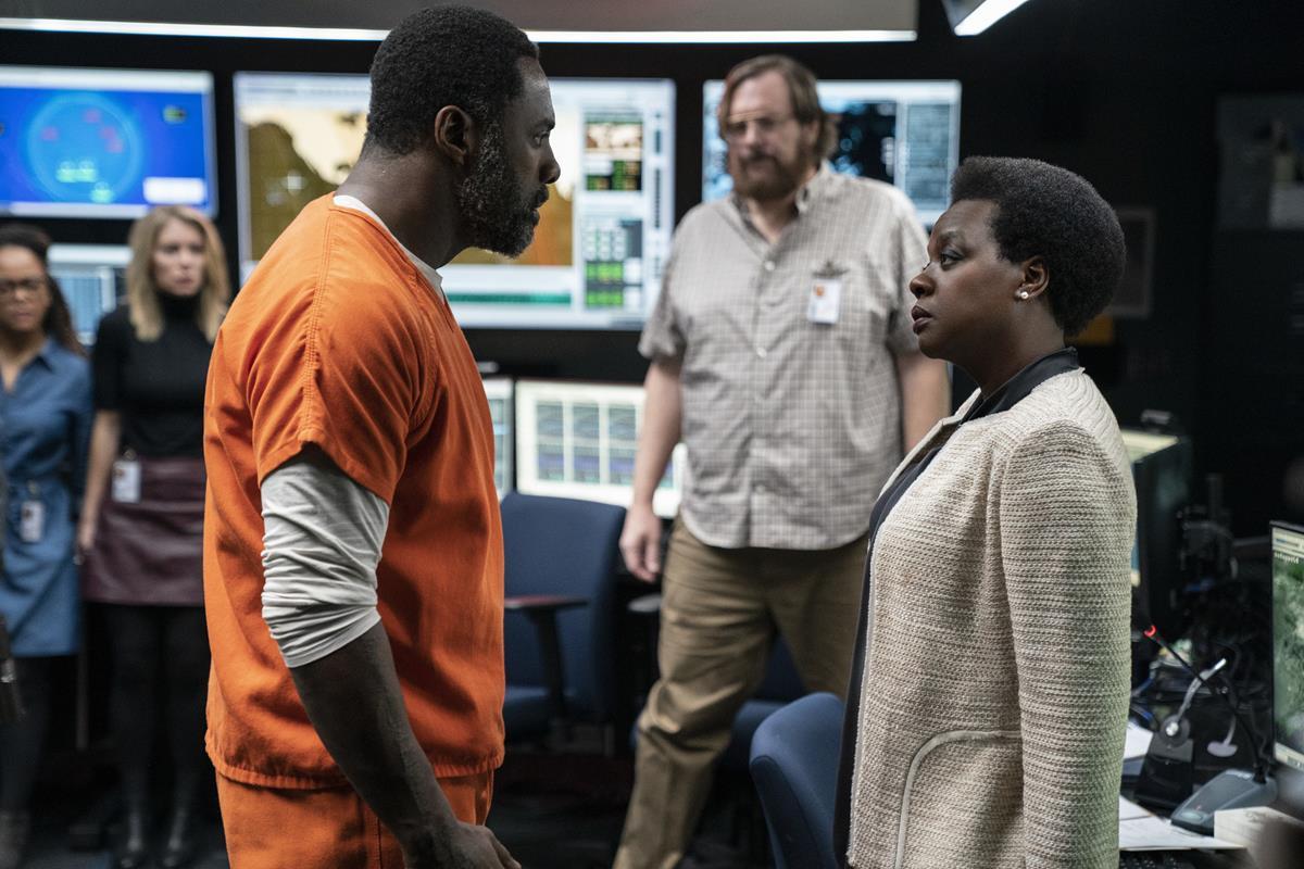 "Idris Elba as Bloodsport, Steve Agee as John Economos and Viola Davis as Amanda Waller in director James Gunn's ""The Suicide Squad."" Cr: Warner Bros. Pictures/DC Comics"