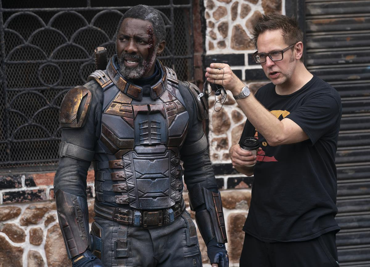 """Idris Elba and writer/director James Gunn on the set of """"The Suicide Squad."""" Cr: Warner Bros. Pictures/DC Comics"""