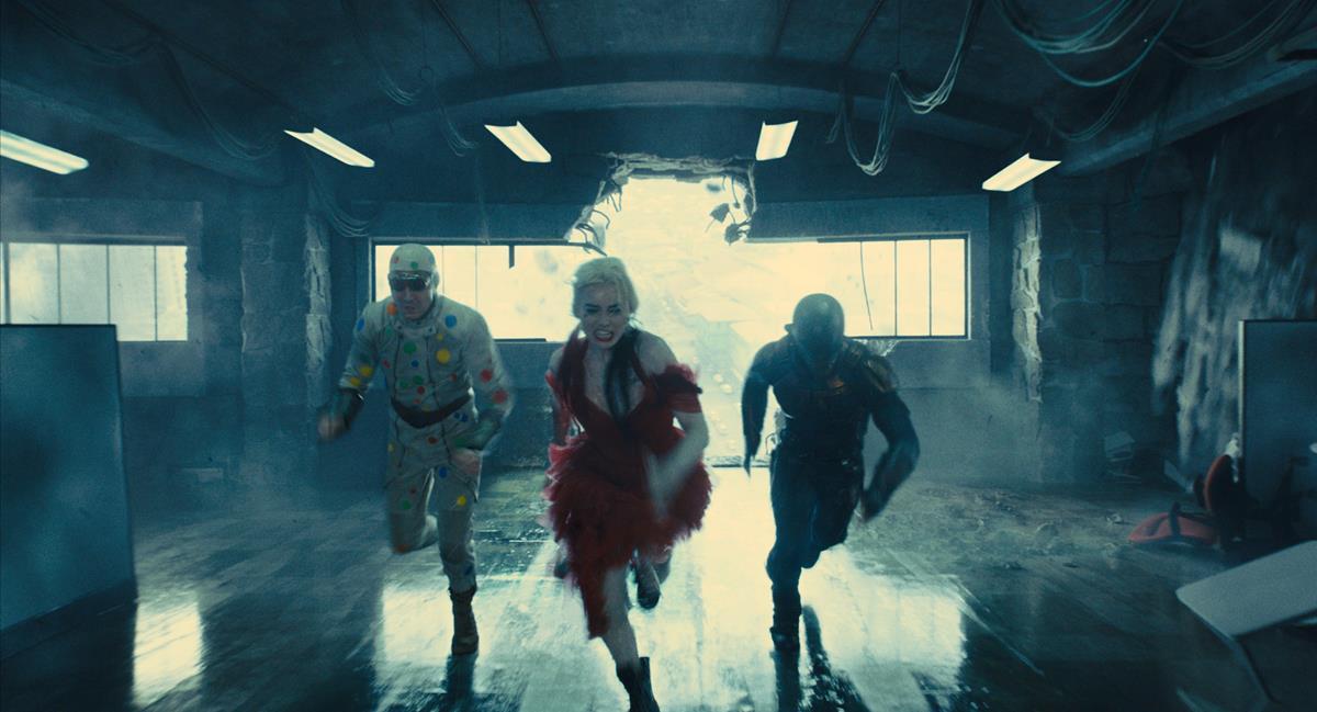 "David Dastmalchian as Polka Dot Man, Margot Robbie as Harley Quinn and Idris Elba as Bloodsport in director James Gunn's ""The Suicide Squad."" Cr: Warner Bros. Pictures/DC Comics"