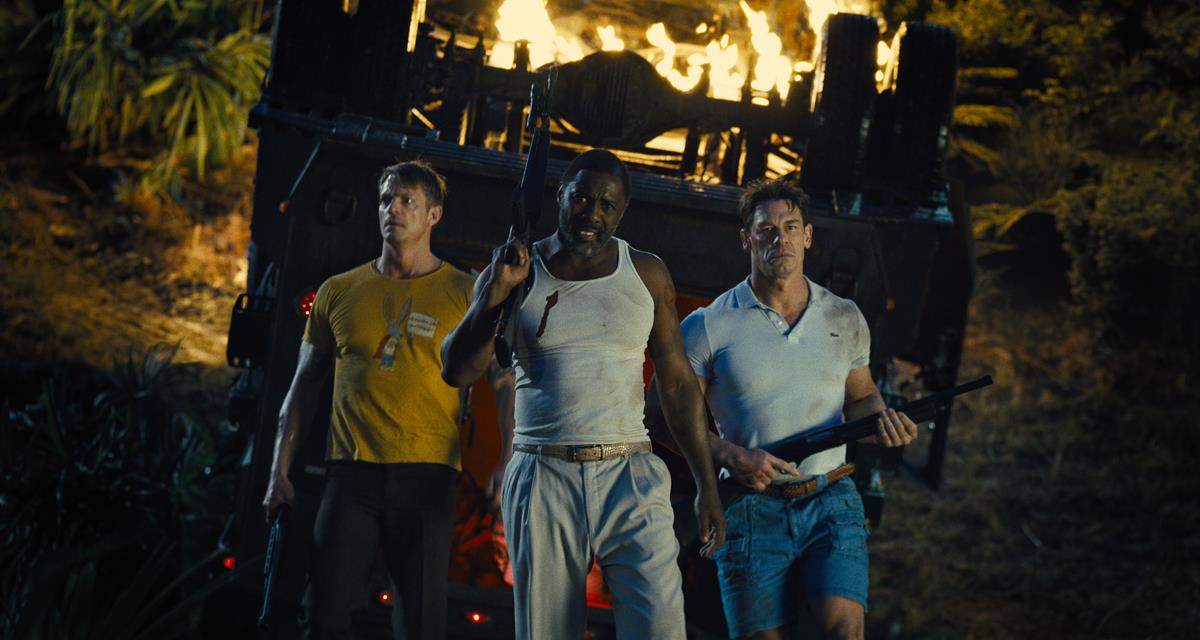 """Joel Kinnaman as Colonel Rich Flag, Idris Elba as Bloodsport and John Cena as Peacemaker in director James Gunn's """"The Suicide Squad."""" Cr: Warner Bros. Pictures/DC Comics"""