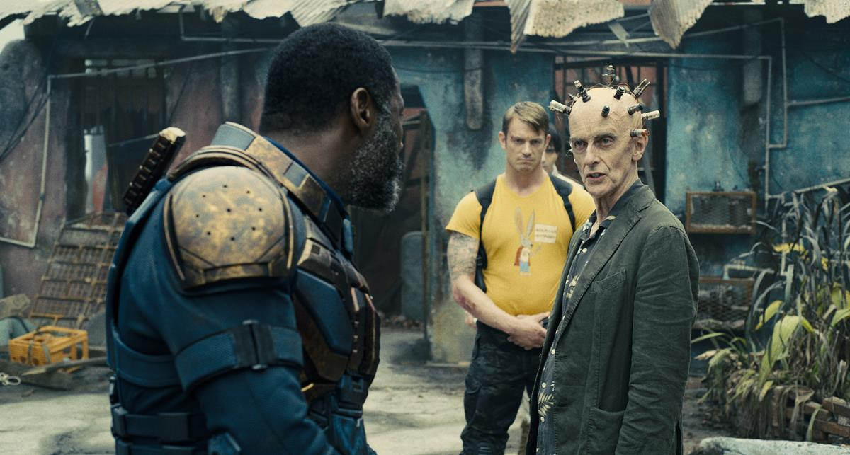 """Idris Elba as Bloodsport, Joel Kinnaman as Colonel Rich Flag and Peter Capaldi as Thinker in director James Gunn's """"The Suicide Squad."""" Cr: Warner Bros. Pictures/DC Comics"""