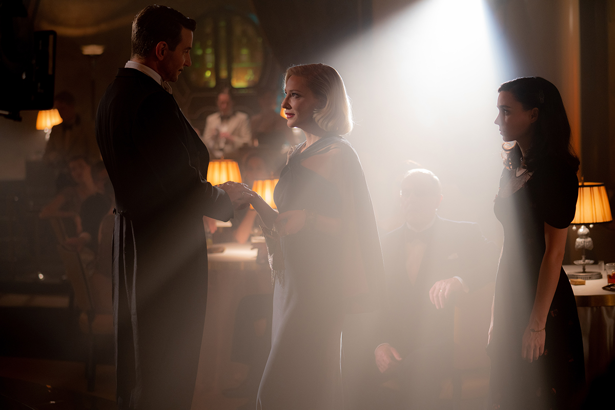 """Bradley Cooper, Cate Blanchett and Rooney Mara in the film """"Nightmare Alley."""" Photo by Kerry Hayes. © 2021 20th Century Studios All Rights Reserved"""