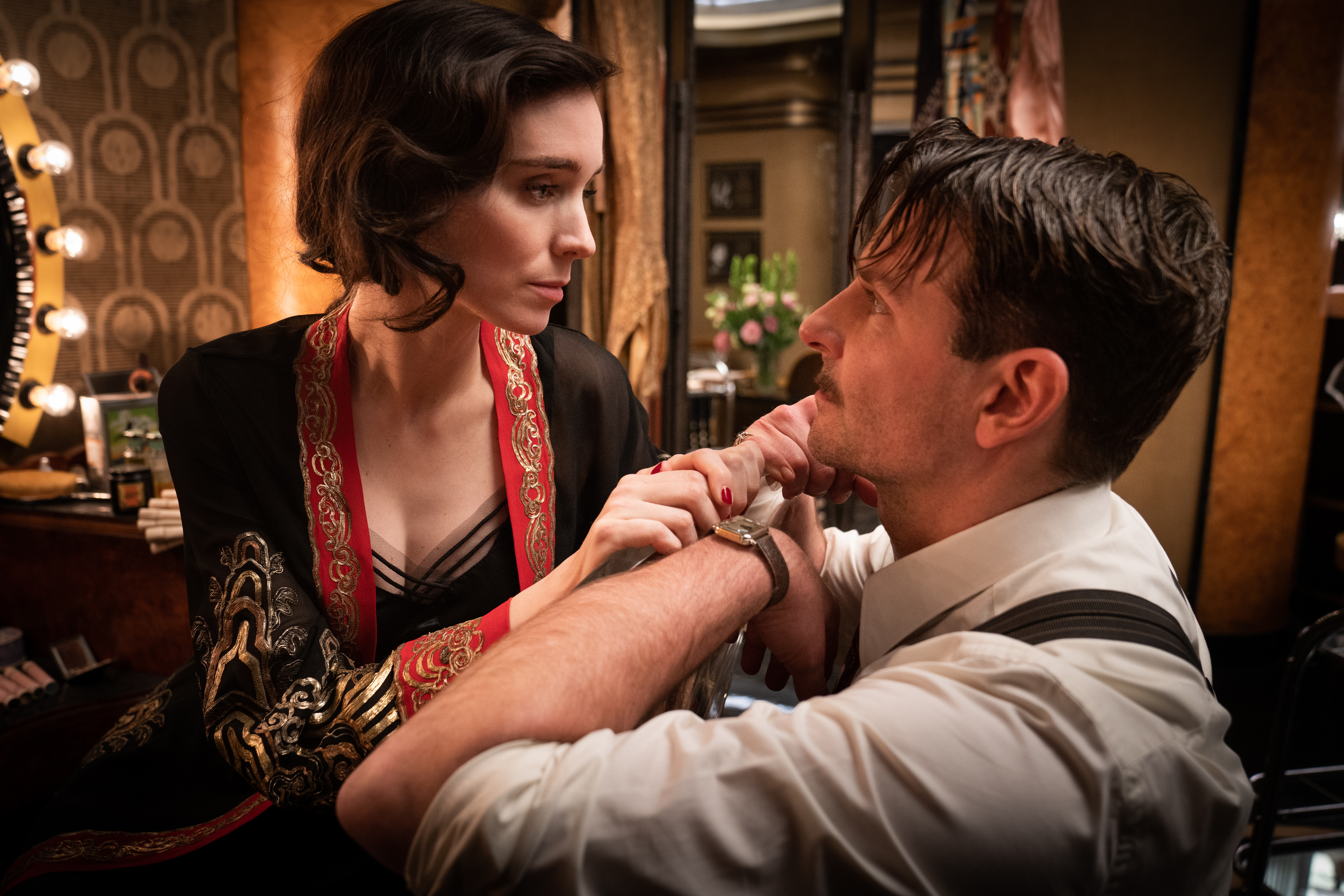 """Rooney Mara and Bradley Cooper in the film """"Nightmare Alley."""" Photo by Kerry Hayes. © 2021 20th Century Studios All Rights Reserved"""