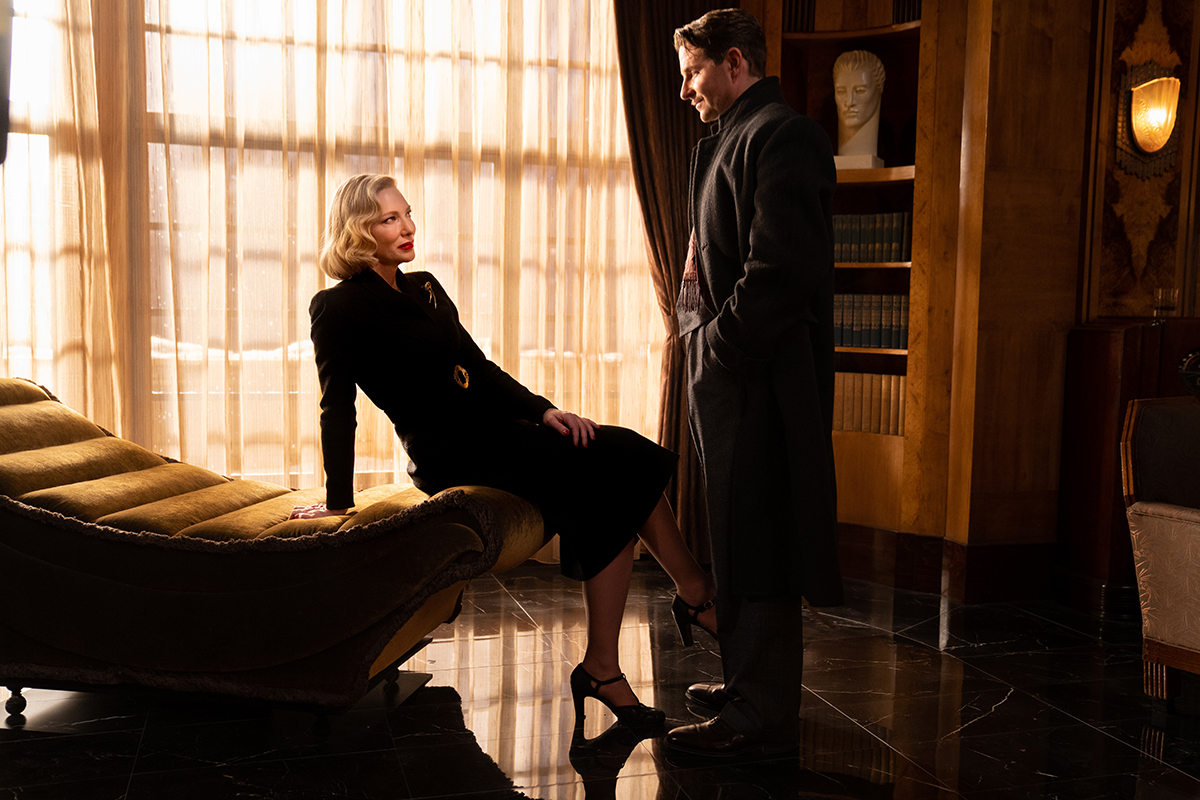 """Cate Blanchett and Bradley Cooper in the film """"Nightmare Alley."""" Photo by Kerry Hayes. © 2021 20th Century Studios All Rights Reserved"""