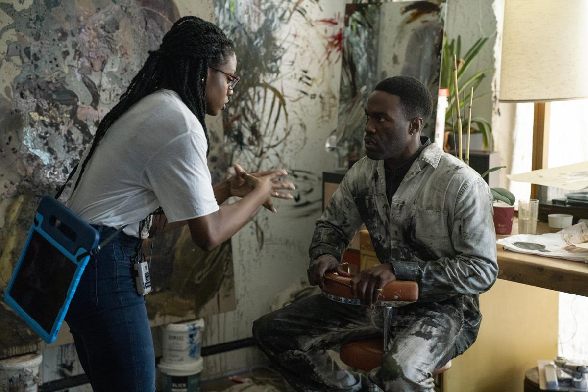 """Director Nia DaCosta and Yahya Abdul-Mateen II on the set of """"Candyman."""" Cr: Universal Pictures"""