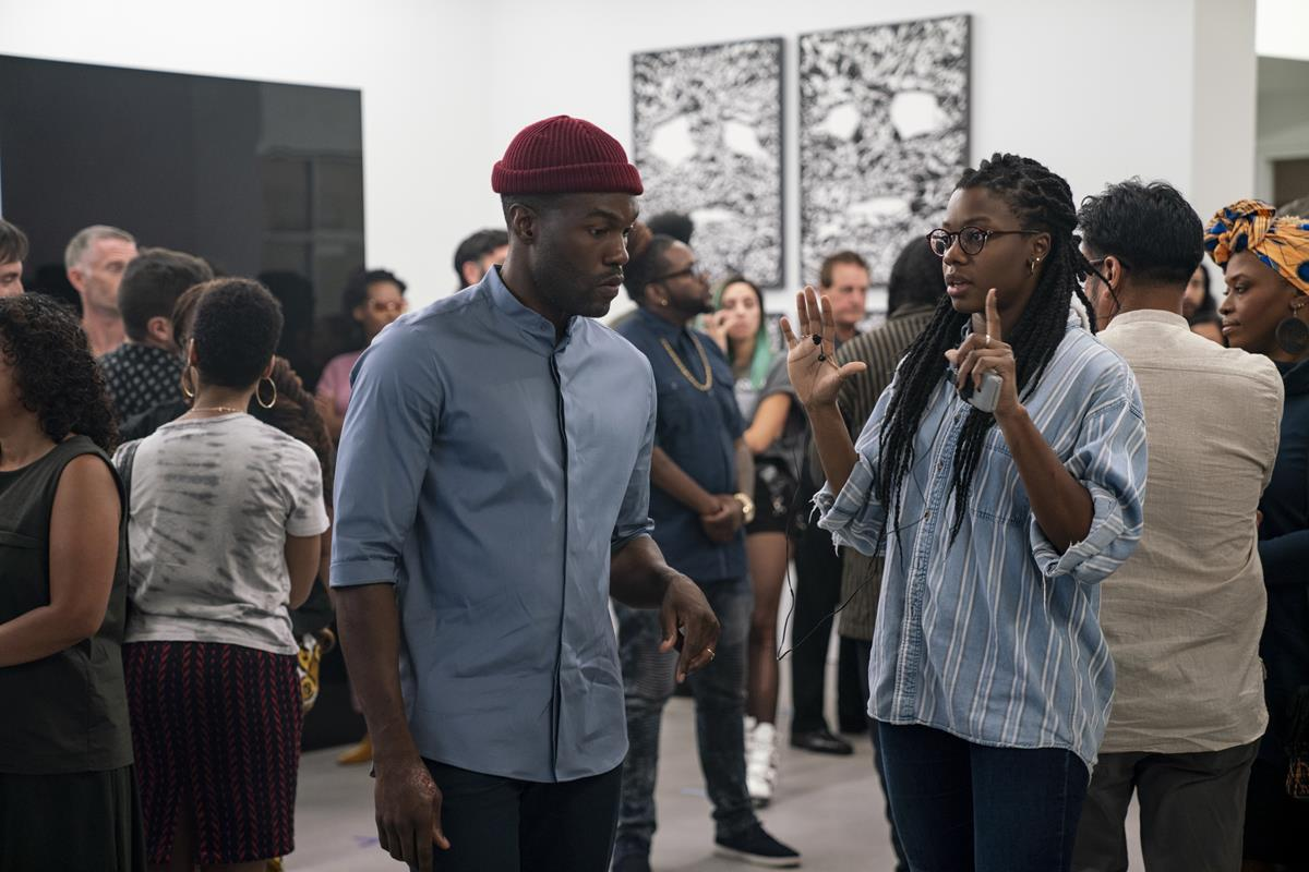 """Yahya Abdul-Mateen II and director Nia DaCosta on the set of """"Candyman."""" Cr: Universal Pictures"""