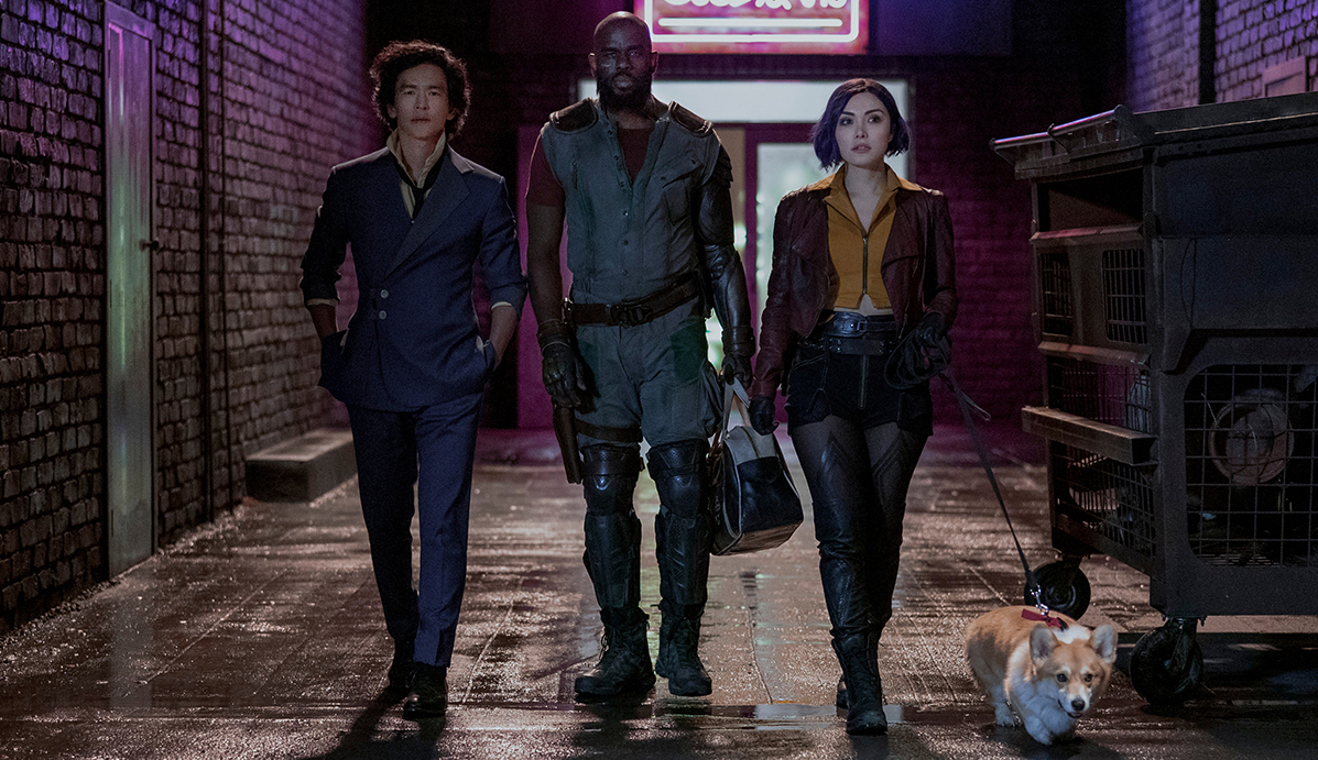 """Cowboy Bebop:"" John Cho as Spike Spiegel, Mustafa Shakir as Jet Black, Daniella Pineda as Faye Valentine and Ein in ""Cowboy Bebop"" Cr. Geoffrey Short/Netflix © 2021"