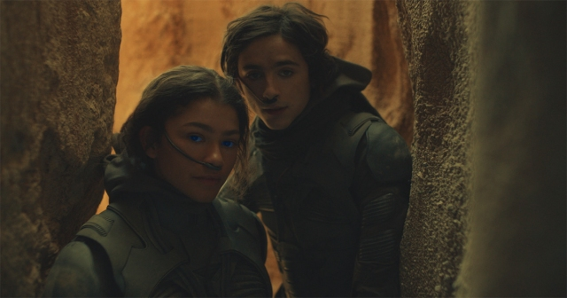 """Copyright: © 2020 Warner Bros. Entertainment Inc. All Rights Reserved. Photo Credit: Courtesy of Warner Bros. Pictures and Legendary Pictures Caption: (L-r) ZENDAYA as Chani and TIMOTHÉE CHALAMET as Paul Atreides in Warner Bros. Pictures' and Legendary Pictures' action adventure """"DUNE,"""" a Warner Bros. Pictures and Legendary release."""