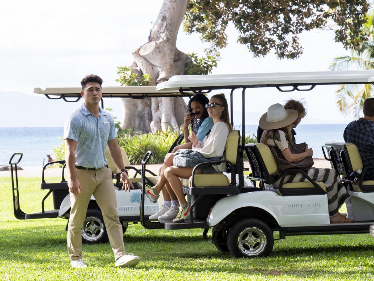 "Kekoa Kekumano as Kai, Brittany O'Grady as Paula, and Sydney Sweeney as Olivia Mossbacher in Episode 1 of ""The White Lotus."" Cr: HBO"