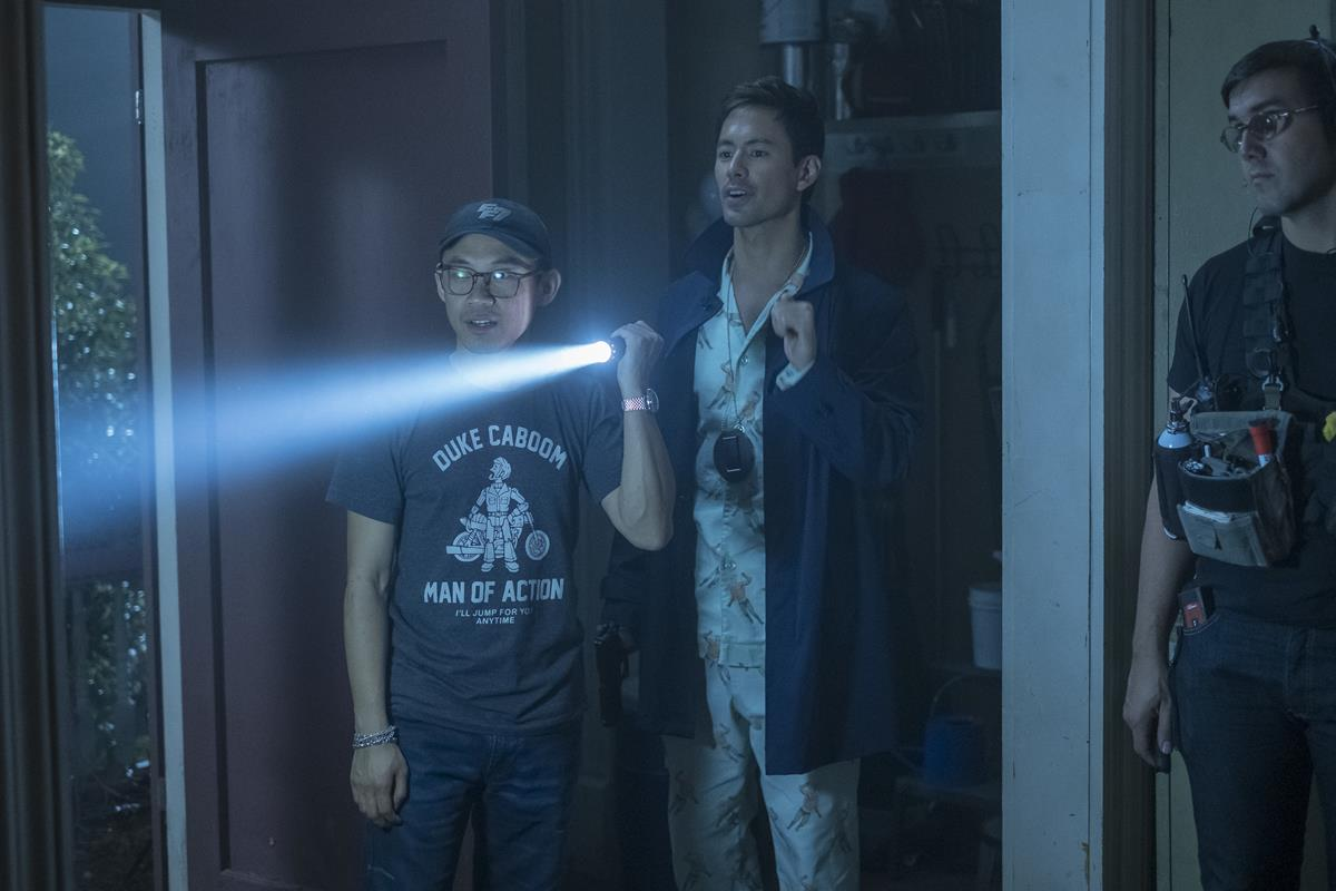 """Director James Wan and George Young on the set of """"Malignant."""" Cr: Warner Bros. Pictures"""