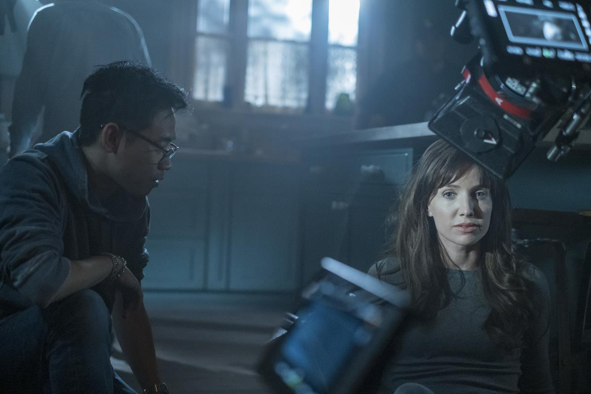 """Director James Wan and Annabelle Wallis on the set of """"Malignant."""" Cr: Warner Bros. Pictures"""
