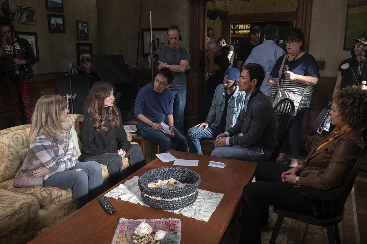 """Maddie Hasson, Annabelle Wallis, James Wan, Michael Burgess, George Young, and Michole Briana White on the set of """"Malignant."""" Cr: Warner Bros. Pictures"""